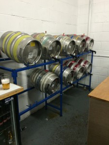 Casks on stillage behind the bar.