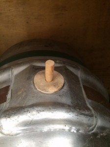 This is a cask with a hard spile in it. Hard spiles do not let much CO2 out or air in and must be replaced with a soft spile before serving beer. If on a beer engine, and a hard spile is in place using the beer engine will cause a vacuum in the cask pulling the CO2 out of solution ruining the beer. There is also a plastic spile which is used in a pub to insert into the shive at night at closing time for a better seal.  The hard wood spiles do not seal totally.