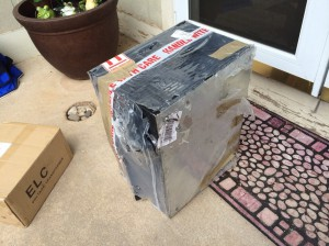 Well, the new chiller arrived. It was shipped with a thin sheet of plastic wrap around it. It's quite banged up.