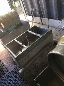 The heated tub with caustic in it