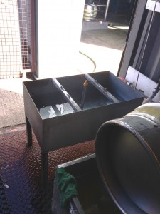 Firkin sitting on the caustic tub, sorry for the photo not being right on the cask
