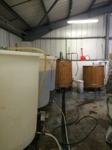 Fermentors on the left, boil kettle and mash tun in the wood clad