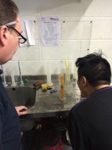 Taking a hydrometer reading