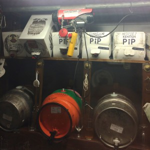 Some of the beers in their stillage area. notice the wench above the white boxes to lift the firkins up to the rack level